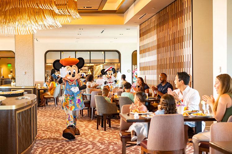 Disney Character dining with Mickey Mouse walking through the restaurant