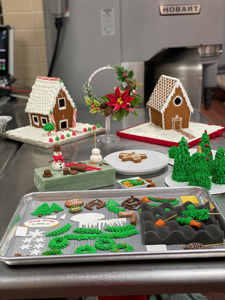 kitchen with gingerbread houses and supplies to make them