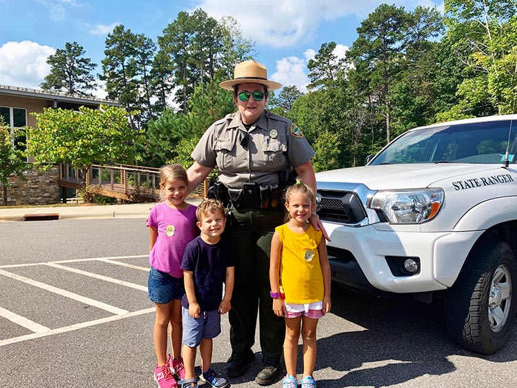 A photo of the Bartos family with a park ranger