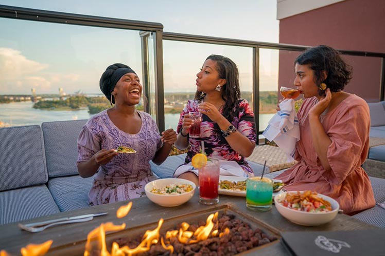 three ladies enjoying outdoor dining in Wilmington
