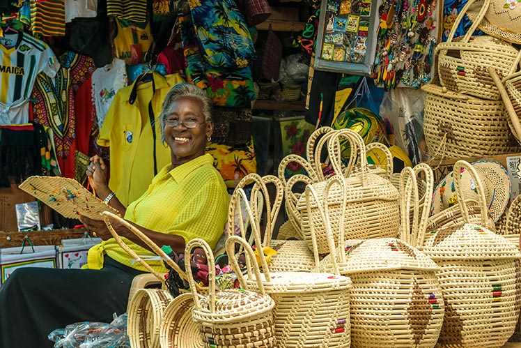 Happy resident from Montego Bay makes baskets for her shop