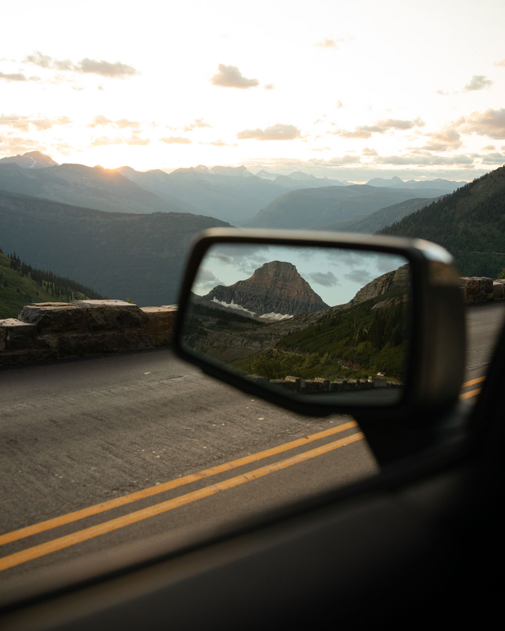 Reflection of Glacier National Prk in car mirror