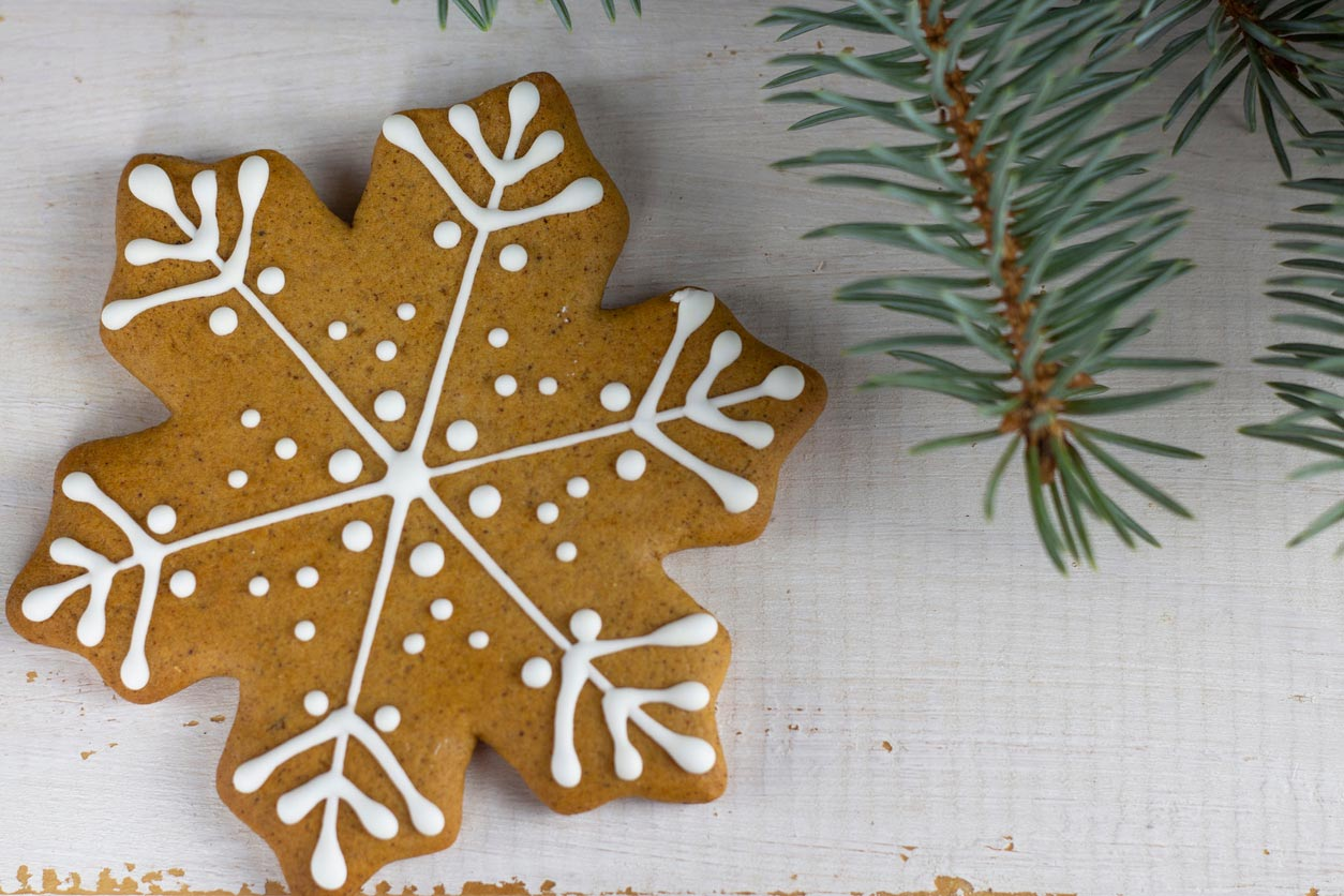 Gingerbread cookie shaped like a snowflake