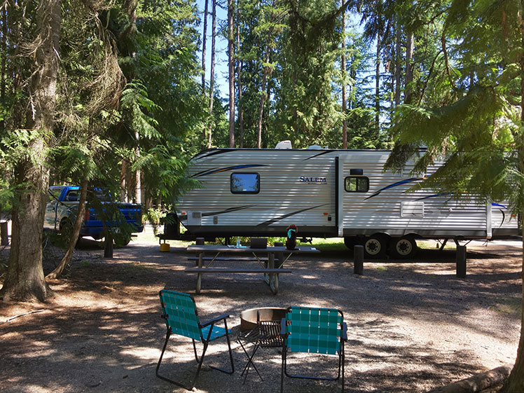 RV parked at a wooded lot
