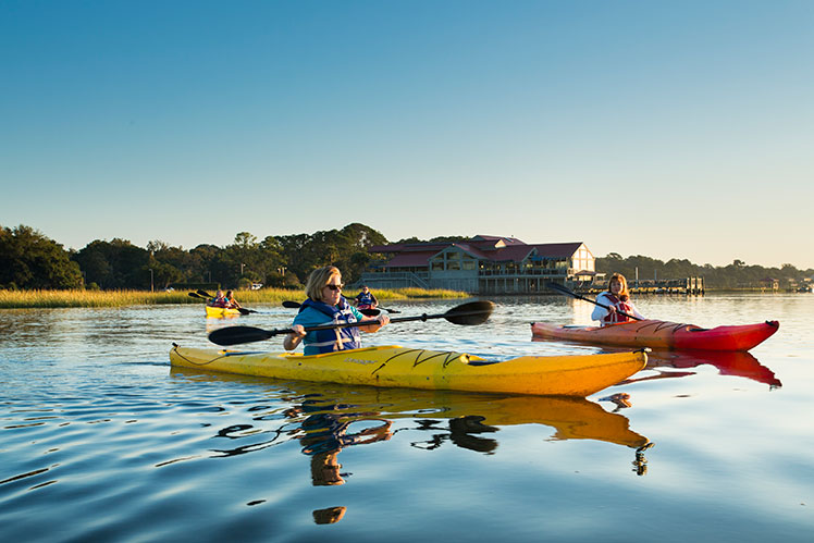 Customers of Hilton Head Health participating in the spa's kayak activity
