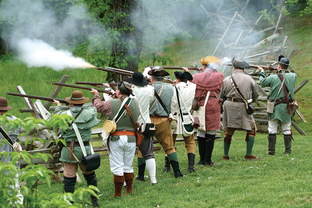 Revolutionary War reenactors acting out a war scene