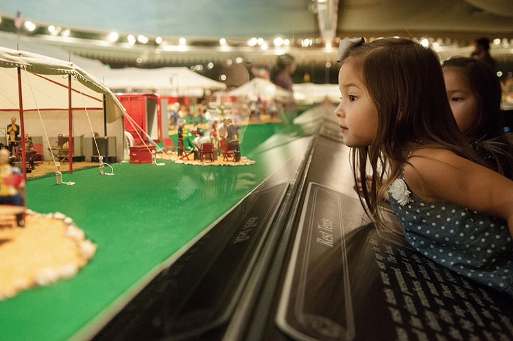 child looking at a display at the Ringling Circus Museum