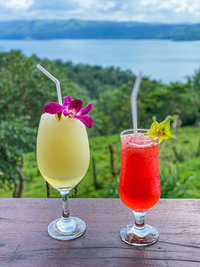 two tropical drinks sitting on a table in Costa Rica