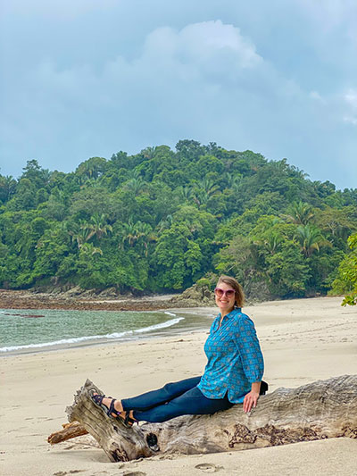 woman sitting at a beach in Costa Rica