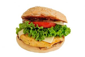 Grilled chicken sandwich with cheese, lettuce and tomato