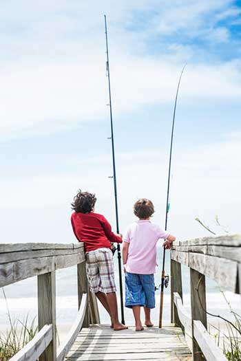 two children with fishing poles