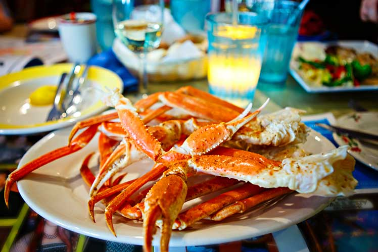 cooked crab legs on a plate at a restaurant in Key West