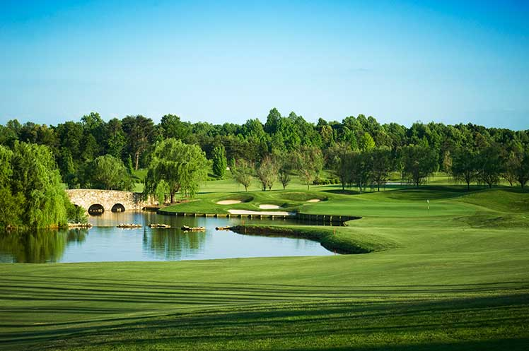 Grandover Resort golf course with a pond and bridge