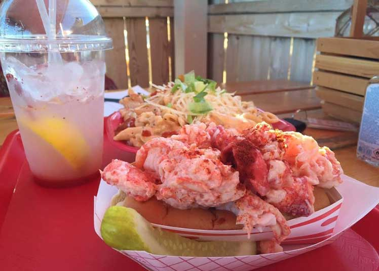 Lobster Roll lunch on an outdoor table at Claws in Maine