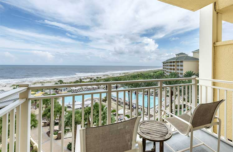 looking at the beach from the porch of a guest room