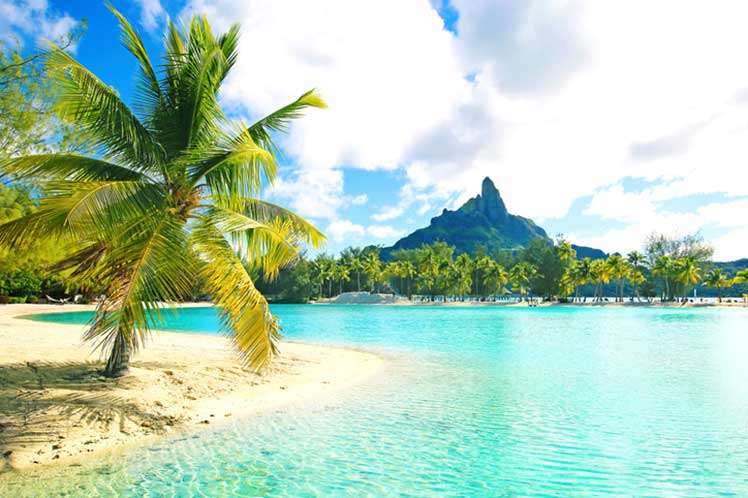 Tahiti beach with mountain in the background