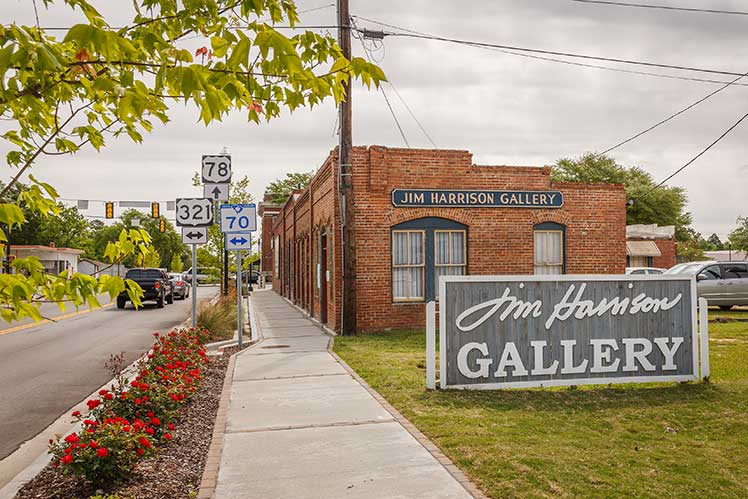 exterior of the Jim Harrison Gallery with gallery sign