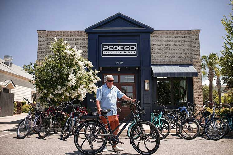 Pedego Electric Bikes office with a display of bikes and the owner outside