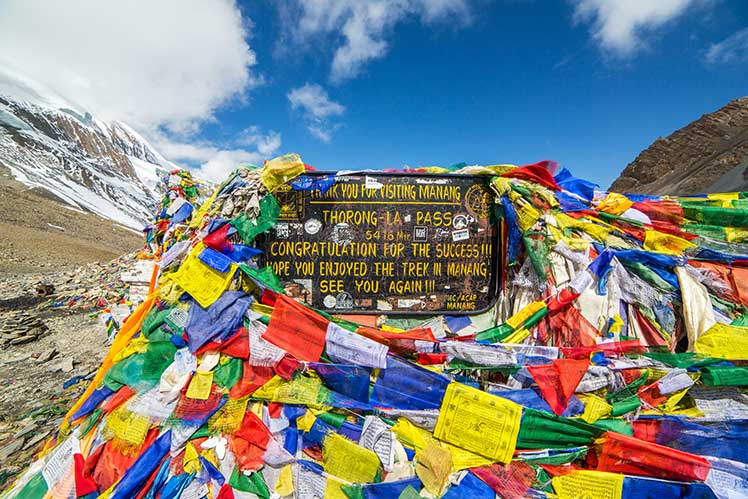 Thorong La pass with a display of colorful prayer flags