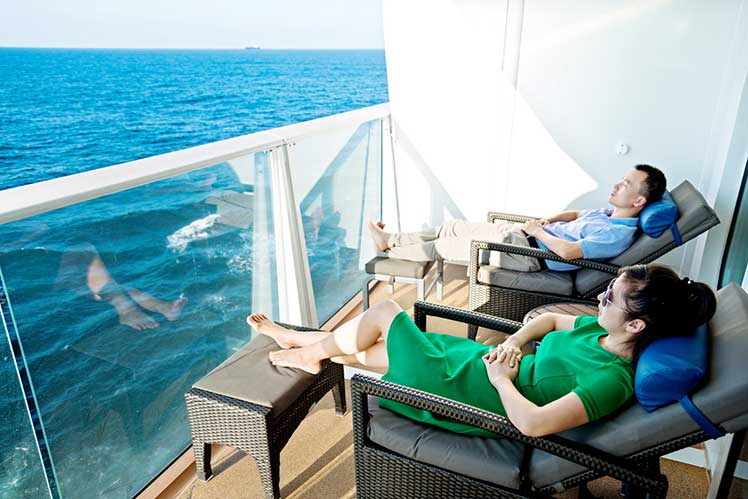 couple relaxing on deck of cruise ship
