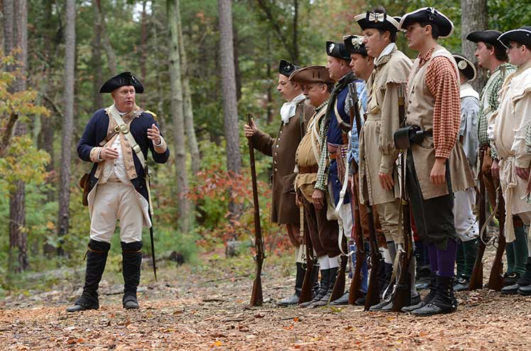a group of Revolutionary War re-enactors gathered together