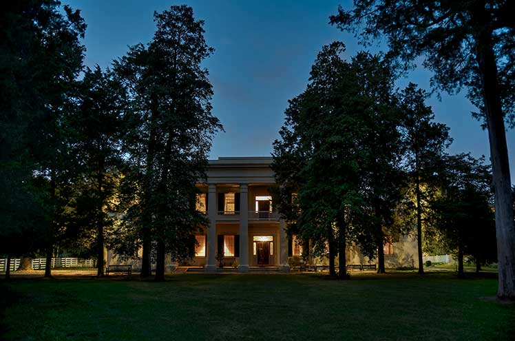 exterior of home at dusk with the lights on